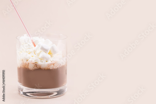 One glass of cocoa with whipped cream and marshmallows