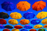 Colorful umbrellas against the blue sky