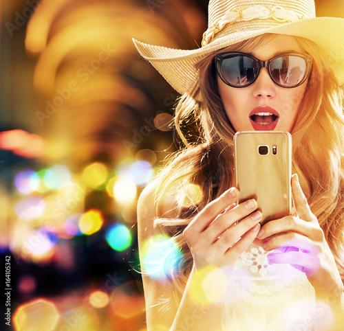 Beautiful, elegant woman using a smartphone