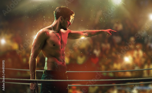 Handsome, muscular man on the fight club ring