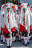 Bulgarian girls dressed in traditional folk costumes - 164107143