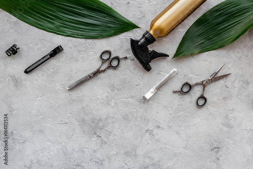 Beauty saloon. Haidressing tools on grey table background top view copyspace