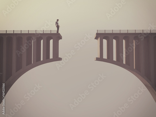 Man in front of a broken bridge
