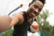 Portrait of african american man on basketball court make selfie