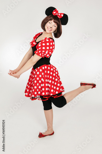 The girl in a mouse costume. Playful girl. Cosplay girl. Poster