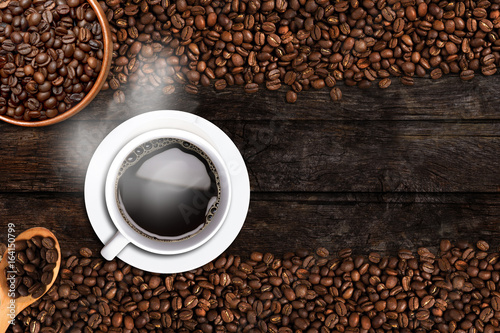 Fotobehang Koffiebonen Coffee cup and beans on old wood table. Top view with copy-space for your text