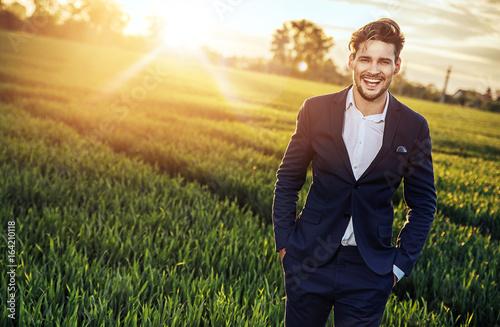 Foto op Aluminium Artist KB Optimistic businessman relaxing on the wheat field