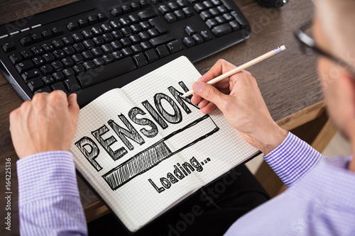 Businessperson Drawing Pension Concept On Notebook