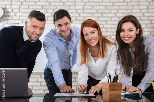 Happy Business People Doing Work At Workplace - 164226507