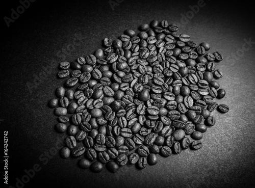 Roasted coffee beans on dark background. Selective focus.