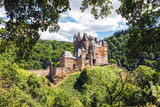 Medieval Eltz Castle nestled in the hills above the Moselle River between Koblenz and Trier, Germany - 164249363