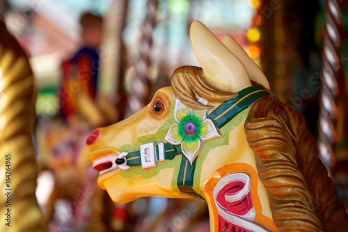 Head of a colorful carousel horse