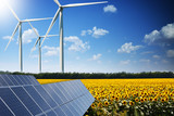 Green energy concept with solar panels and wind turbines on a sunflower field - 164266757