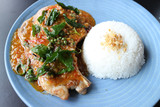 pork chop with spicy sauce, peppercorns, fried basil and rice on blue dish - 164268385