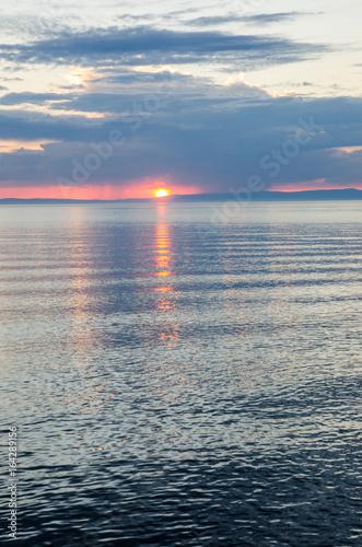 Obraz na Plexi Beautiful sunset above the sea and mountain