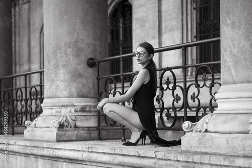 Young woman wearing long black dress