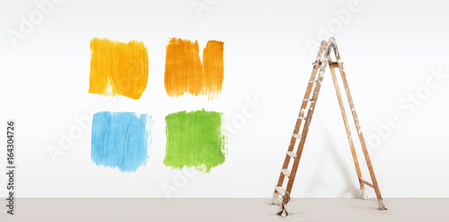 painter ladder with paint colors samples, isolated on blank white wall background, web banner