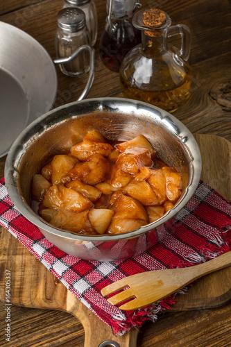 Chunks of chicken in marinade.
