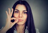 Keep a secret, woman zipping her mouth shut. Quiet concept - 164312724