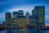 London, England - The skyscrapers of Canary Wharf, the famous financial district of London at blue hour