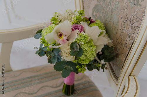Small tender bouqet of fresh spring flowers lying on chair