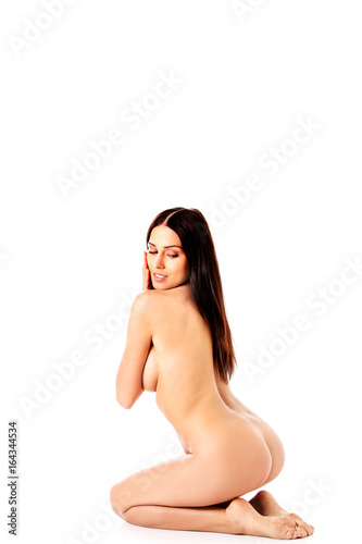 Nude woman kneeling on the floor