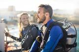 Scuba diver on a boat having fun - 164355166