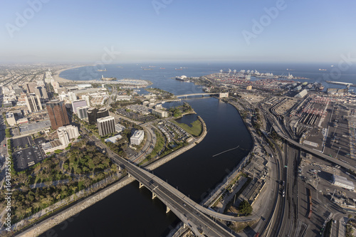 Aerial view of streets, buildings, port facilities and the end of the Los Angeles river in downtown Long Beach, California.