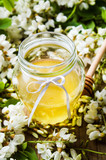 Acacia flowers and honey in the jar - 164393101