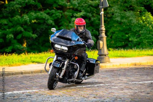 Rider on black custom motorbike