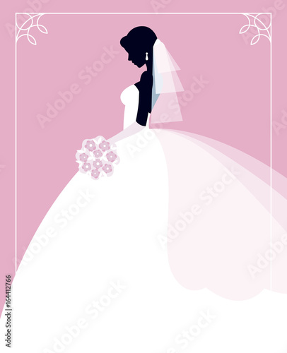 Profile of the bride in a wedding dress with a bouquet of flowers in her hands