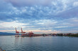 Vancouver skyline with port terminal at sunset, British Columbia, Canada. The city harbor at sunset with clouds.
