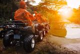 Fototapety atv sport vehicle team ready to adventure in mud track