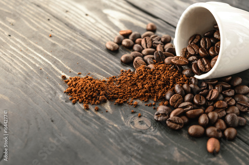 morning coffee bean and cup top on wood - 164427741