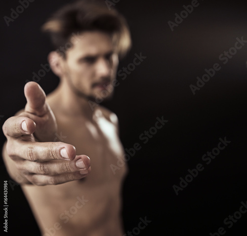 Defocused portrait of a handsome, nude guy