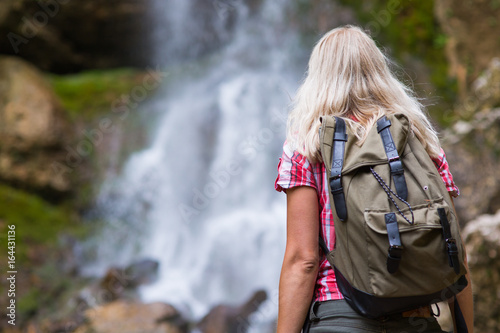 blonde woman tourist with backpack - 164431136
