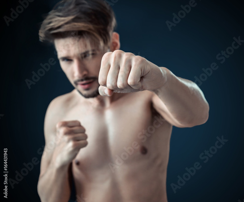 Portrait of a nude boxer