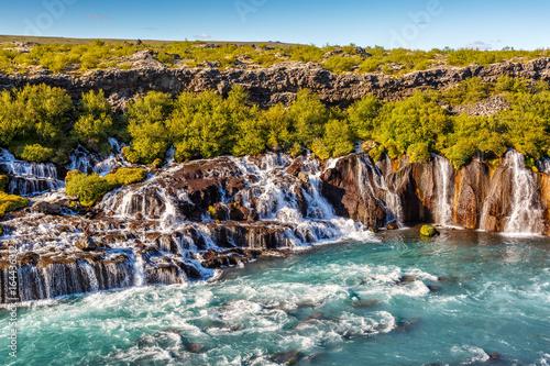 Hraunfossar waterfall in Iceland at sundown - 164436312
