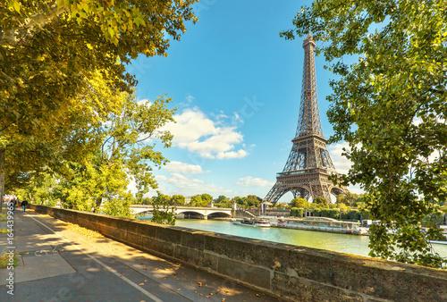 The Eiffel tower in Paris. Jena Bridge is a bridge spanning the River Seine in Paris.