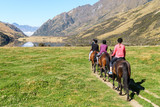 Horse riding in mountains by lake - 164441539