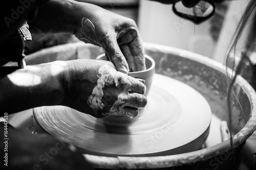 Hands working at the pottey  wheel