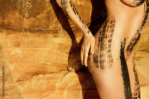 Poster Female body with trace of car tire on her body