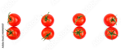 Close-up of organic, juicy, fresh, healthful bright red tomatoes isolated on a white background, top view. A group of whole and fresh red tomatoes.