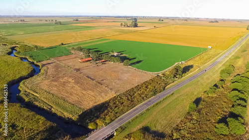 Beautiful aerial view of cultivated field and route