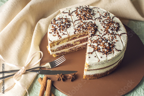 Poster Beautiful homemade layered sponge cake with white cream in rustic style with the