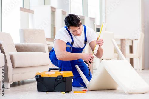 Furniture repairman working in store - 164489751