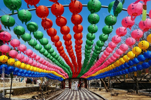 Colorful lanterns lining a walkway at a monastery in South Korea