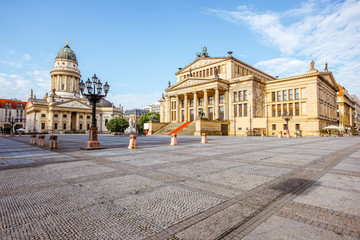 Viiew on the Gendarmenmarkt square with concert house building and German cathedral during the morning light in Berlin city