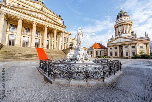 Viiew on the Gendarmenmarkt square with concert house building and French cathedral during the morning light in Berlin city