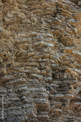 Cliff of rock mountain. Texture of the rock. Close-up.  Surface of the rock, stone background and texture.